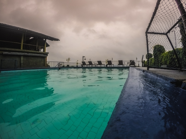An evening view from Girithale Hotel's pool