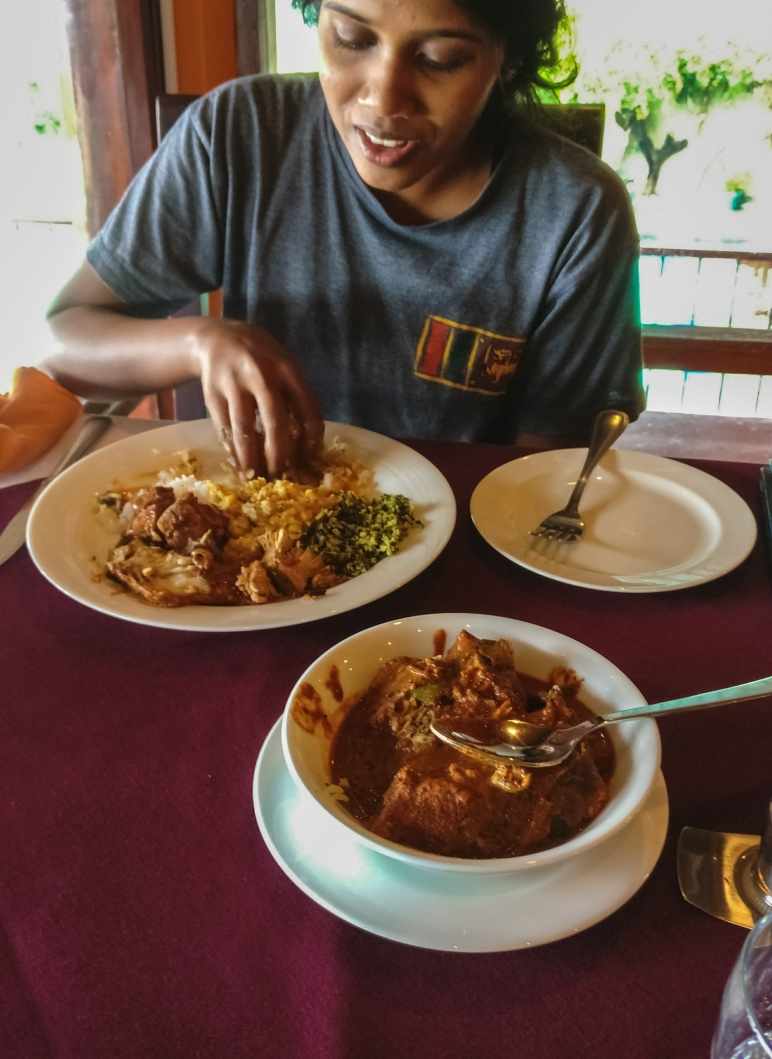 Enjoying a delicious fresh water fish curry prepared by Hotel Girithale