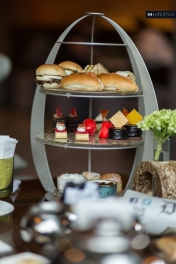 Traditional three tiered tea tray with an array of local & British delicacies